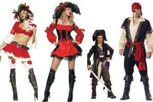 man, woman, boy and girl in Halloween costume