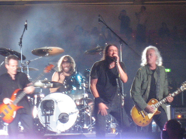 Image of Foo Fighters band group in concert.