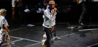 Image of Pharrell Williams in concert.