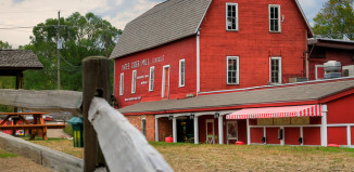 Image of red bard at Yates Cider Mill in Michigan.